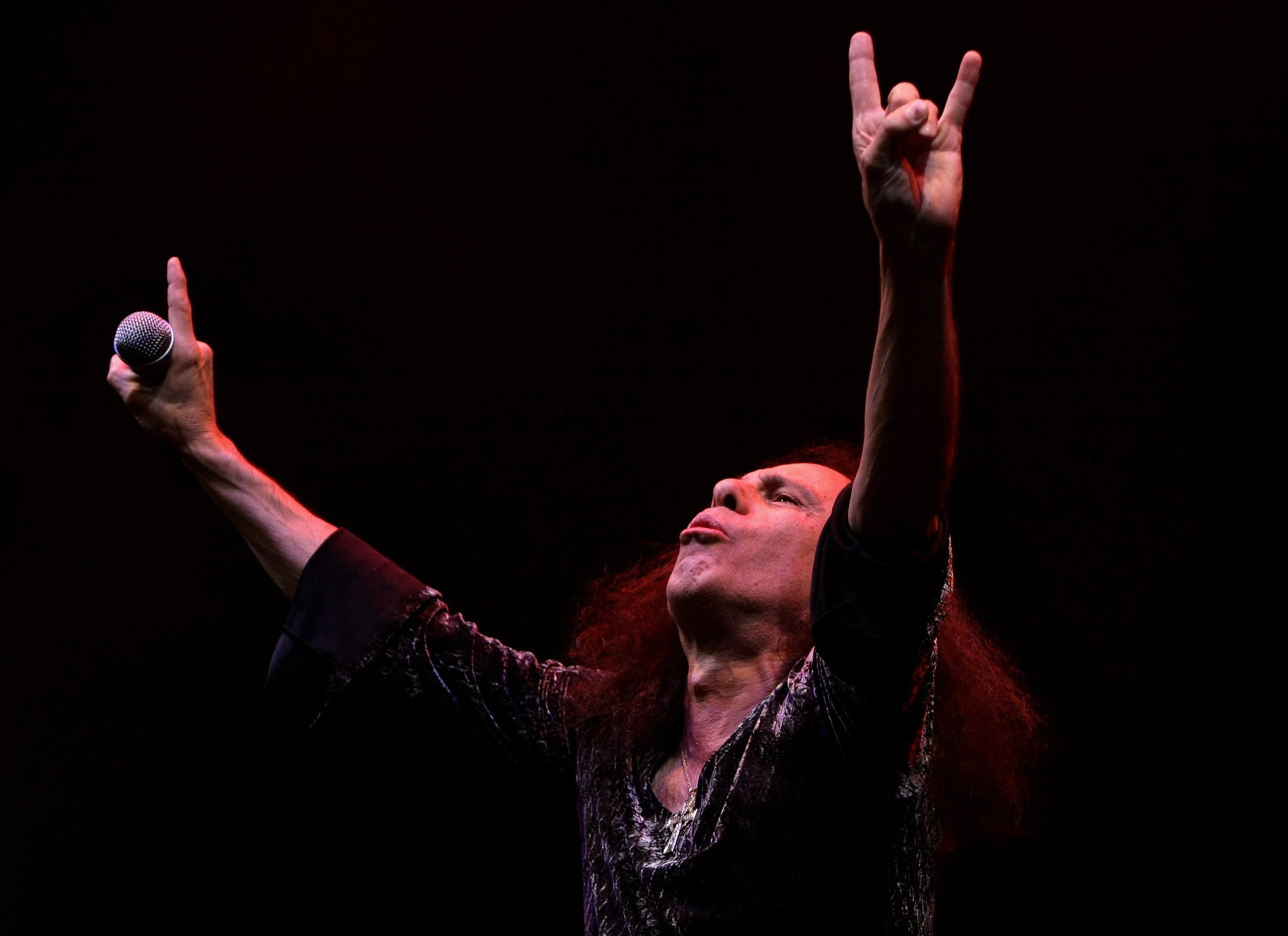 MELBOURNE, AUSTRALIA-AUGUST 10: Ronnie James Dio performs on stage with Heaven and Hell during their Heaven and Hell 2007 tour at Rod Laver Arena on August 10, 2007 in Melbourne, Australia. Heaven and Hell is a musical collaboration featuring Black Sabbath members Tony Iommi and Geezer Butler along with former members Ronnie James Dio and Vinny Appice. (Photo by Robert Cianflone/Getty Images)