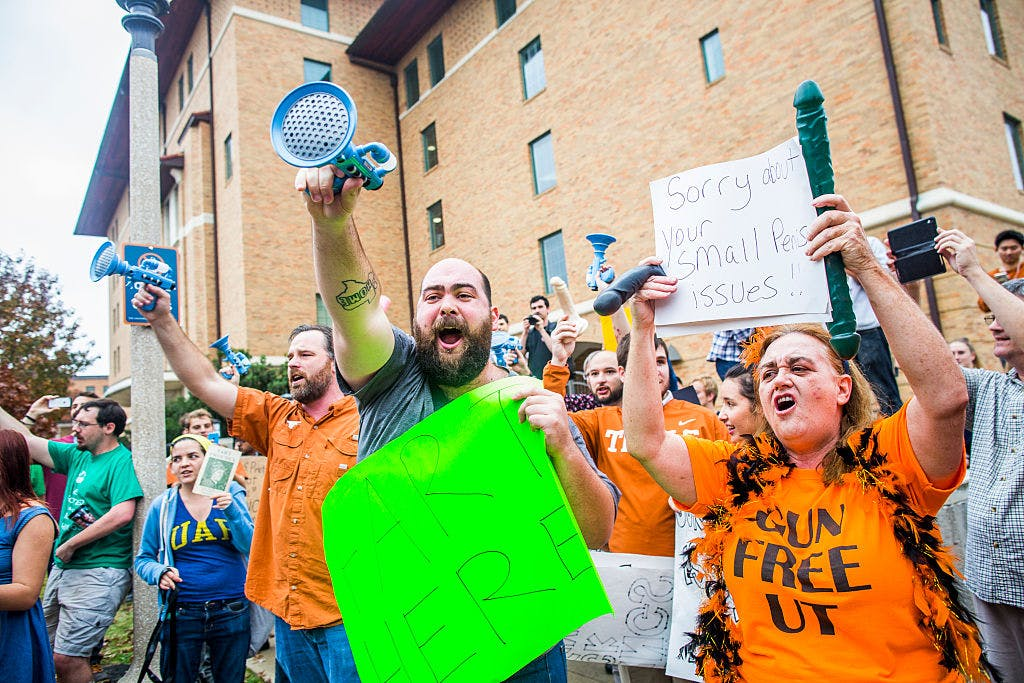 Gun activists march close to The University of Texas campus in Austin, Texas December 12, 2015.