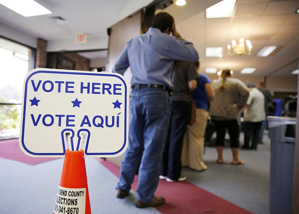 Voters stand in line to cast their ballots inside Calvary Baptist Church March 1, 2016 in Rosenberg, Texas.