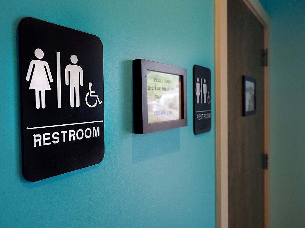 Unisex signs hang outside bathrooms May 10, 2016 in Durham, North Carolina.