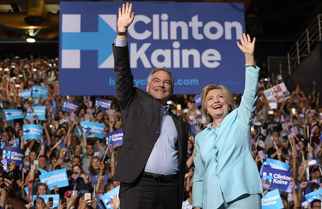 MIAMI, FL - JULY 23: Democratic presidential candidate former Secretary of State Hillary Clinton and Democratic vice presidential candidate U.S. Sen. Tim Kaine (D-VA) greet supporters during a campaign rally at Florida International University Panther Arena on July 23, 2016 in Miami, Florida.