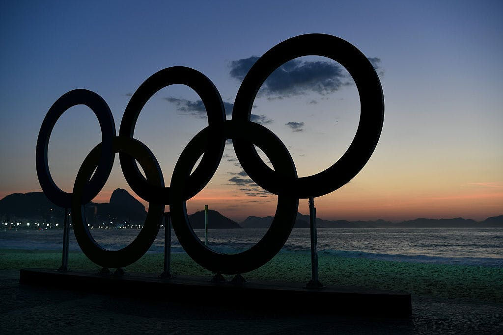 RIO DE JANEIRO, BRAZIL - AUGUST 06: The Olympics Rings at sun rise on Copabana Beach on August 6, 2016 in Rio de Janeiro, Brazil.