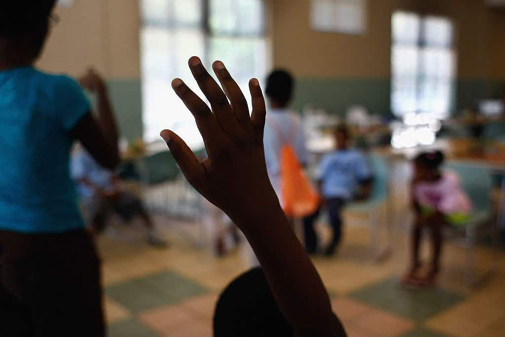 A child asks a question during daycare play events at the Center of Hope shelter for homeless women and children on June 16, 2009 in Dallas, Texas.