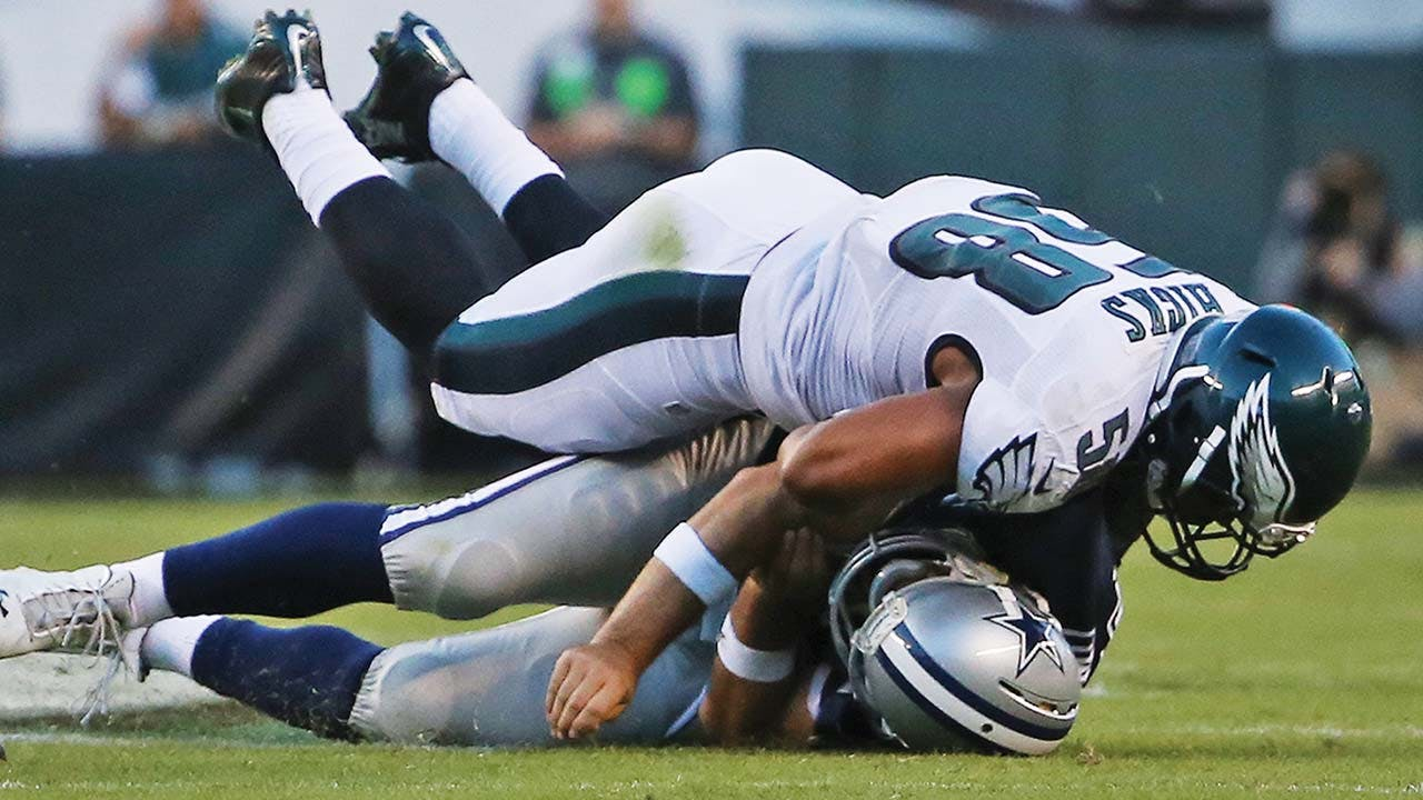 Philadelphia Eagles linebacker Jordan Hicks slams Romo to the turf, rebreaking his clavicle, on September 20, 2015. opposite page: Romo celebrates a touchdown—one of five—against the Denver Broncos on October 6, 2013, a game in which he threw for more than 500 yards.