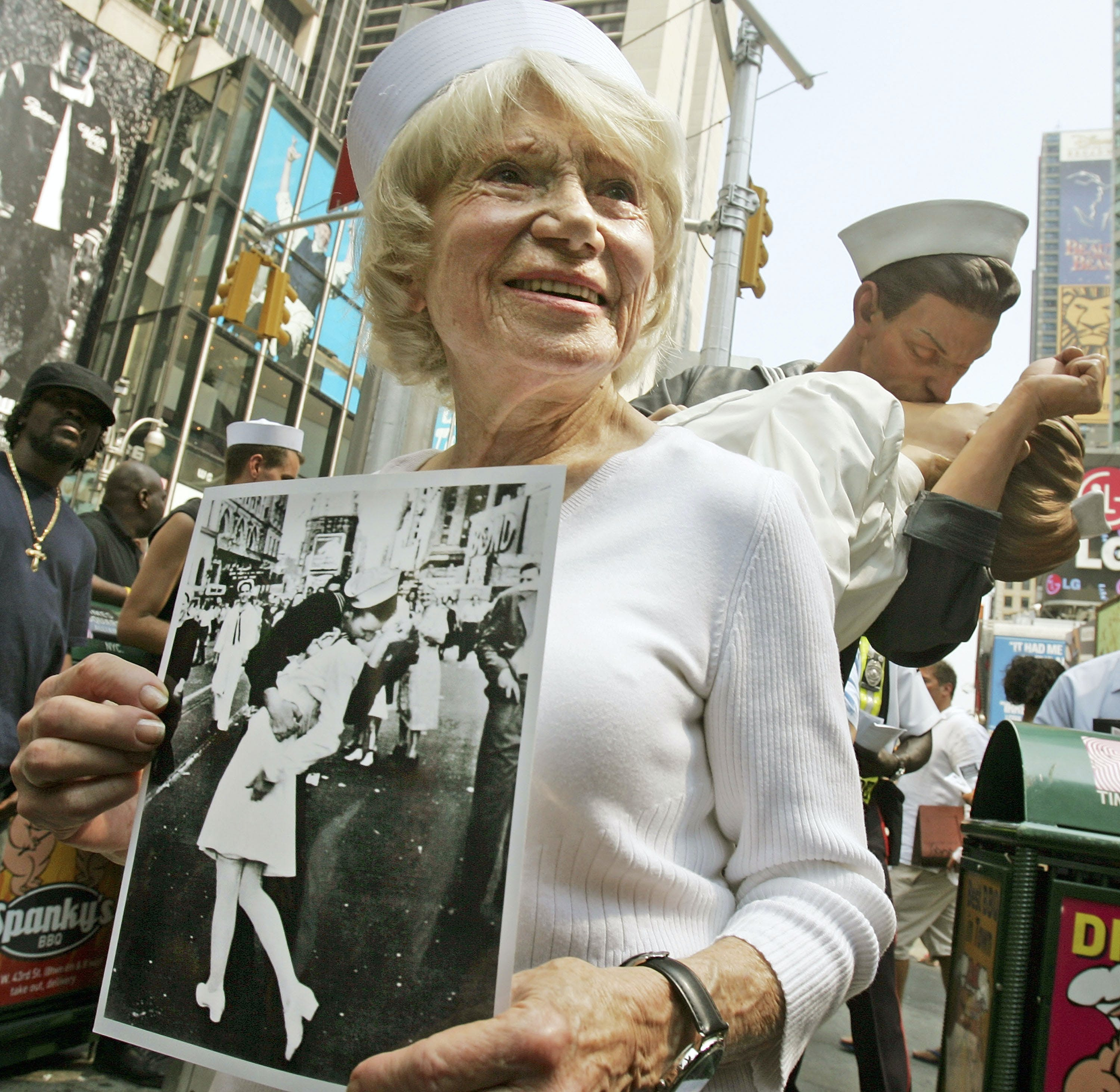 Eighty six-year-old Edith Shain stands in Times Square in front of a statue of her famous kiss with a sailor on V-J Day at the end of World War II August 11, 2005 in New York City. The famous kiss was photographed by Alfred Eisenstaedt and the unveiling of the statue coincides with the 60th anniversary of the end of World War II on August 14, 1945. The sailor in the photograph has never been positively identified.