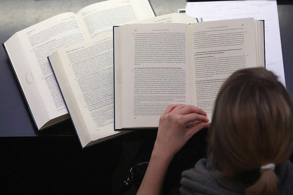 A student studies textbooks in the law faculty at Humboldt University prior to the beginning of the winter semester on October 11, 2011 in Berlin, Germany.