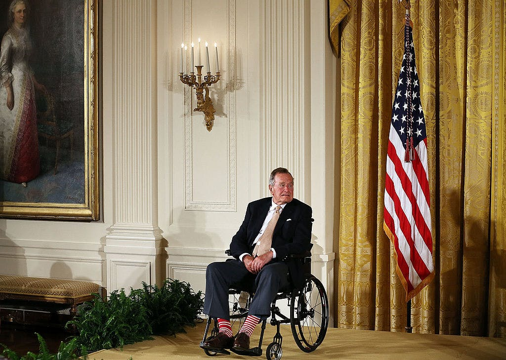 WASHINGTON, DC - JULY 15: Former President George H. W. Bush sits in a wheelchair during an event in the East Room at the White House, July 15, 2013 in Washington, DC.