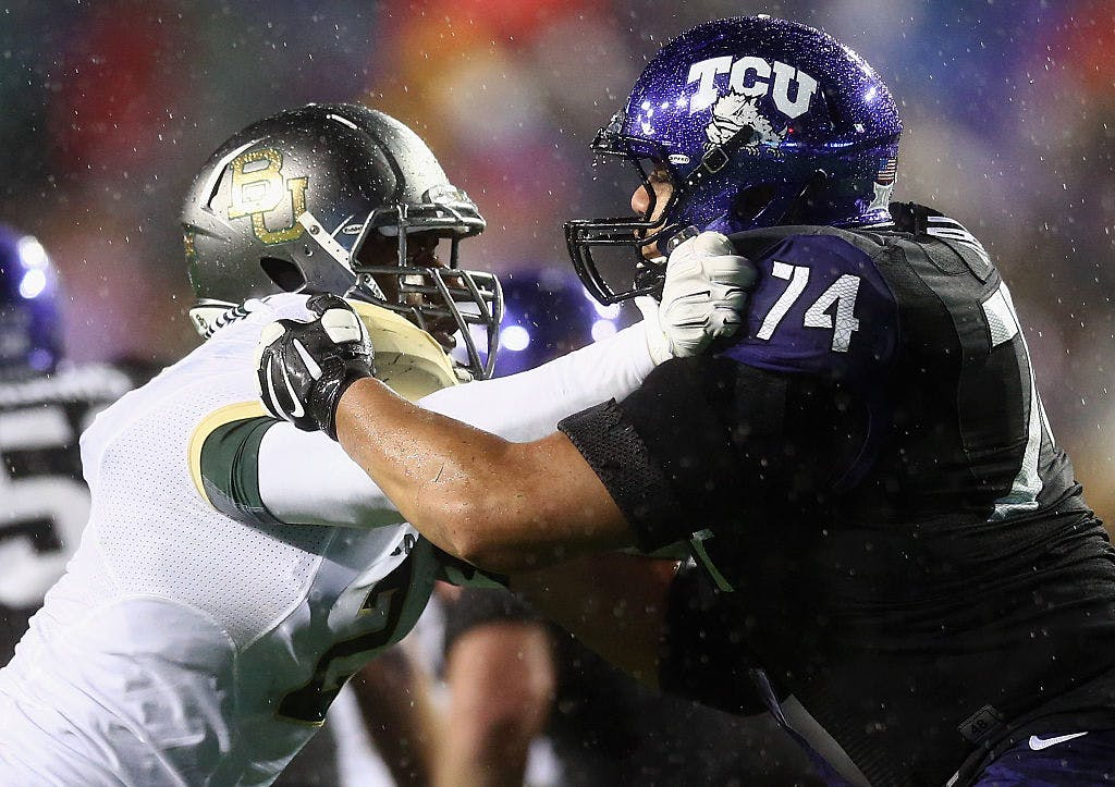 FORT WORTH, TX - NOVEMBER 27: (L-R) Shawn Oakman #2 of the Baylor Bears and Halapoulivaati Vaitai #74 of the TCU Horned Frogs during the second quarter at Amon G. Carter Stadium on November 27, 2015 in Fort Worth, Texas.