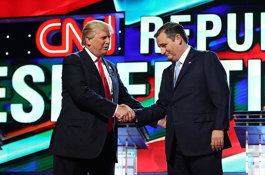 Republican presidential candidates Donald Trump and Sen. Ted Cruz (R-TX) shakes hands on stage as they arrive for the CNN, Salem Media Group, The Washington Times Republican Presidential Primary Debate on the campus of the University of Miami on March 10, 2016 in Coral Gables, Florida.