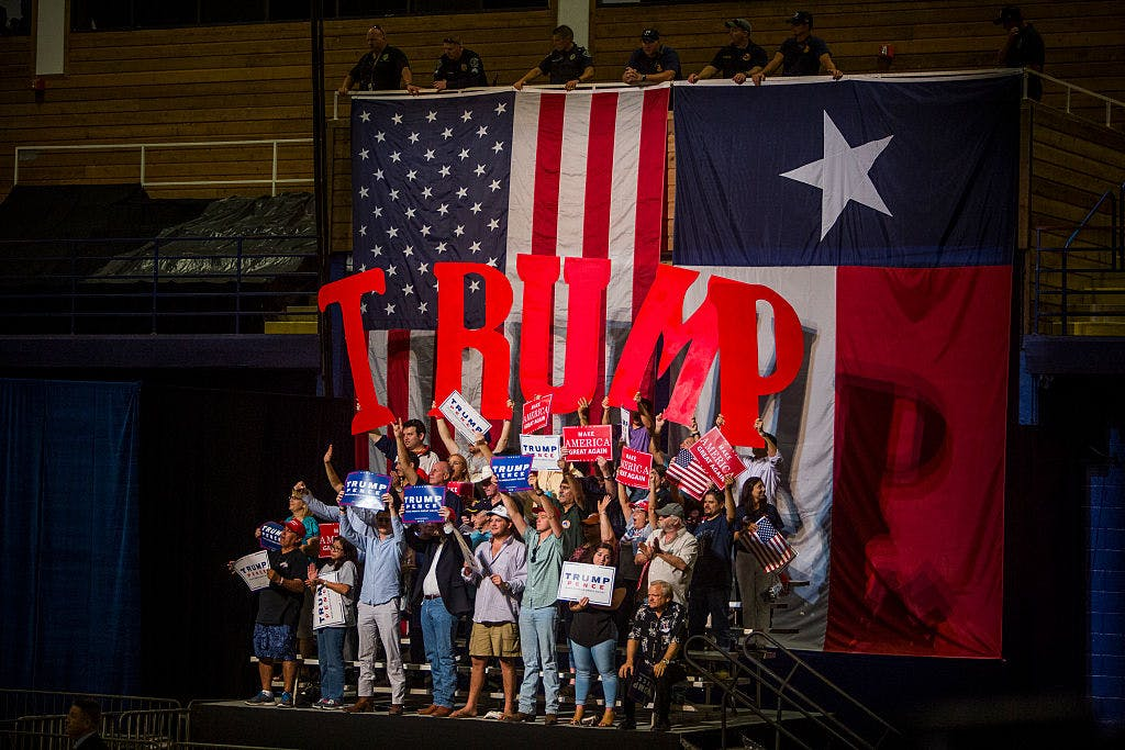 AUSTIN, TX - AUGUST 23: Supporters of Republican presidential candidate Donald Trump cheer during a rally at the Travis County Exposition Center on August 23, 2016 in Austin, Texas.
