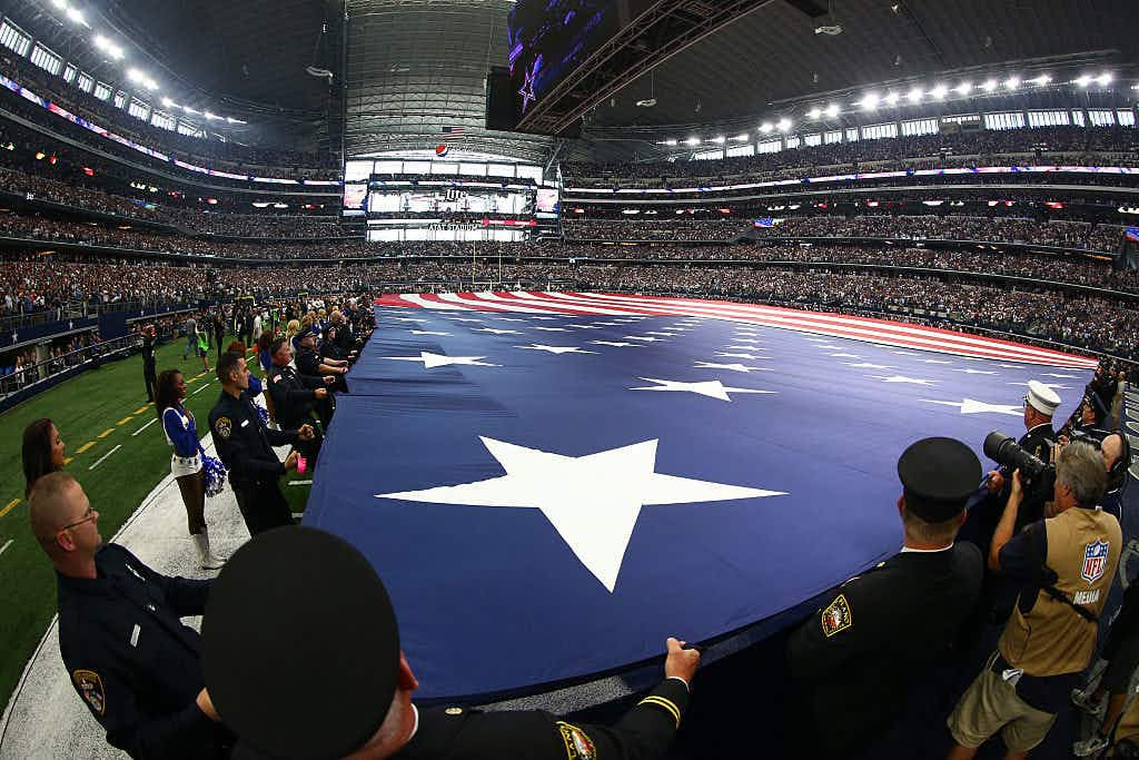 ARLINGTON, TX - SEPTEMBER 11: A general view of a giant American flag held on the field during pre-game ceremonies prior to the game between the Dallas Cowboys and New York Giants before at AT&T Stadium on September 11, 2016 in Arlington, Texas.