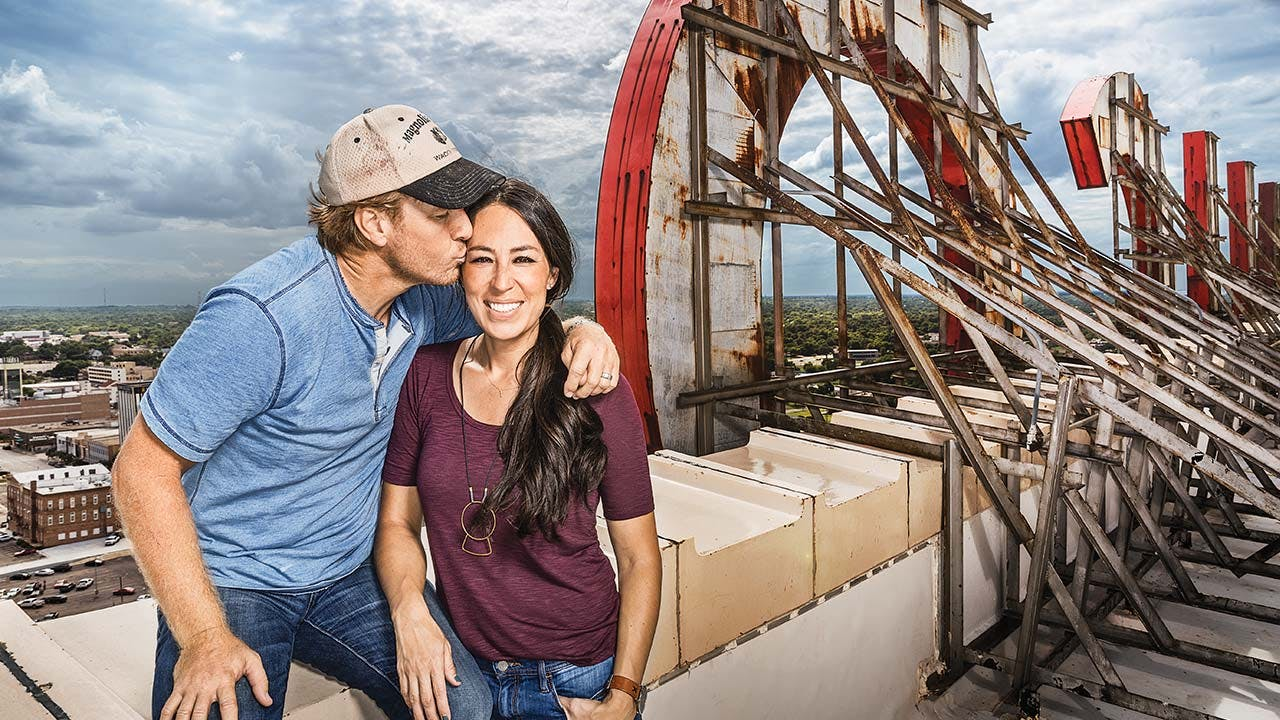 Chip and Joanna, who have been married since 2003, on the roof of the Alico, the tallest building in Waco.