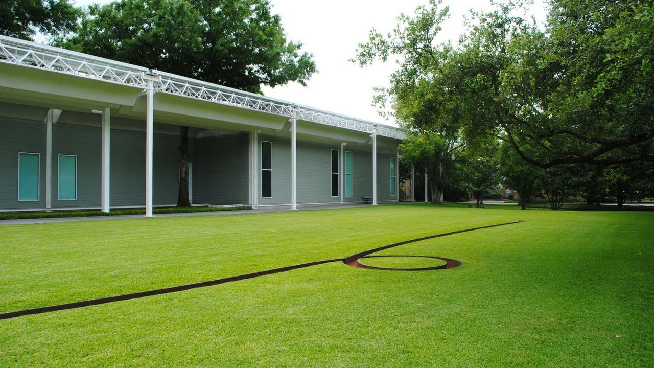 "One of Michael Heizer's ""earth sculptures,"" in front of the Menil Collection, in Houston."