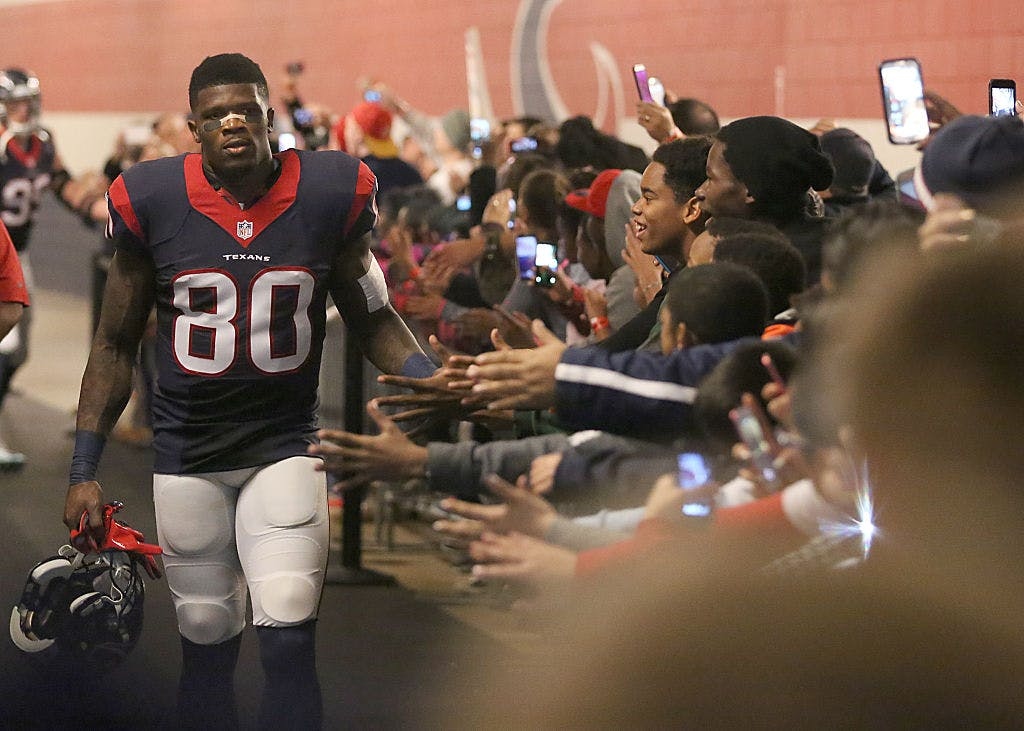 Andre Johnson #80 of the Houston Texans shakes hands with fans before playing the Jacksonville Jaguars in a NFL game on December 28, 2014 at NRG Stadium in Houston, Texas.