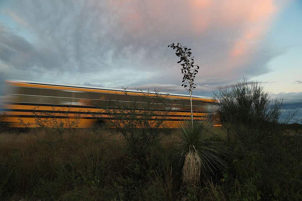A school bus passes through the desert on September 29, 2016 near Saint David, Arizona.