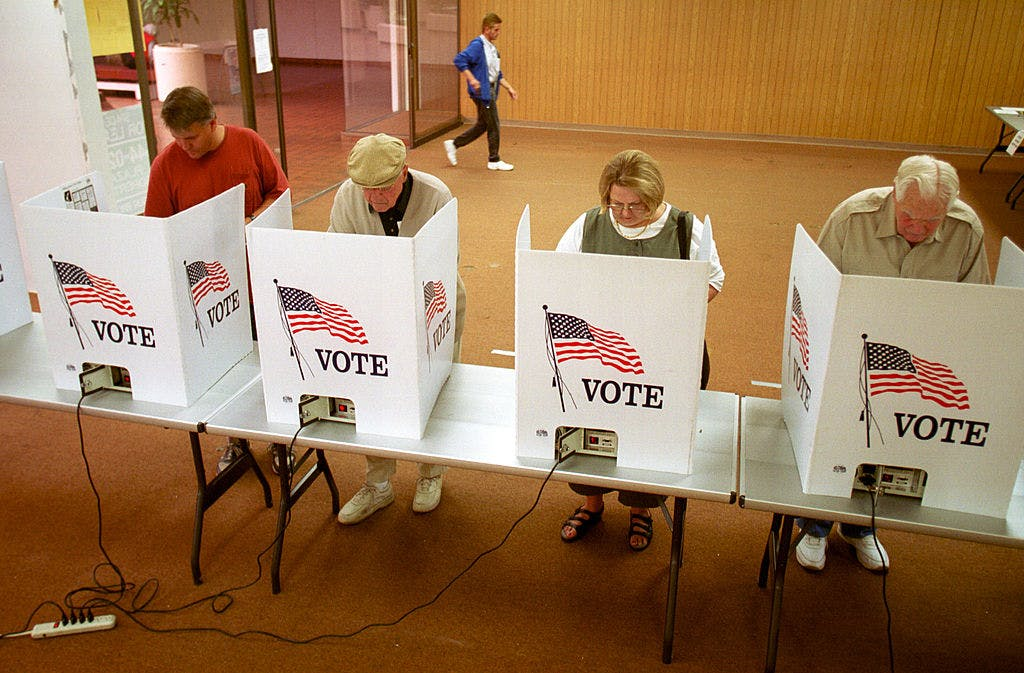 Residents of El Paso, Texas cast their ballot for president of the United States in early voting, October 23, 2000.