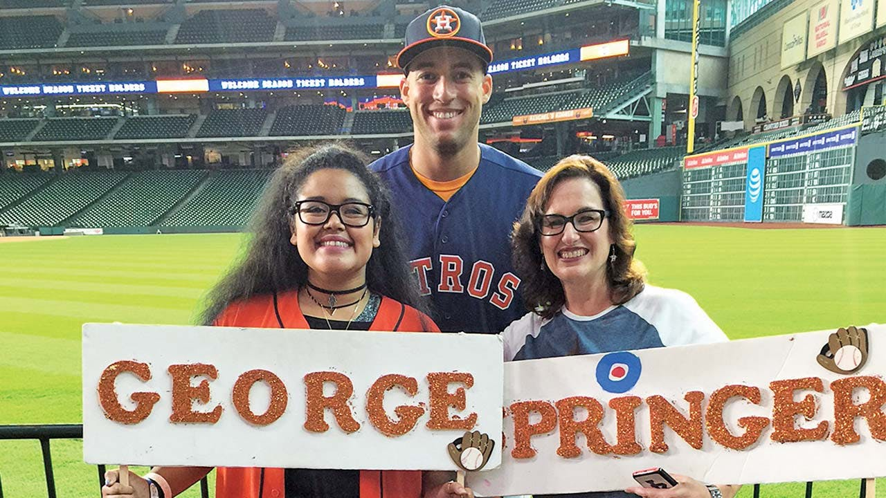 Cheryl and Kayla, with their favorite player, George Springer, in July.