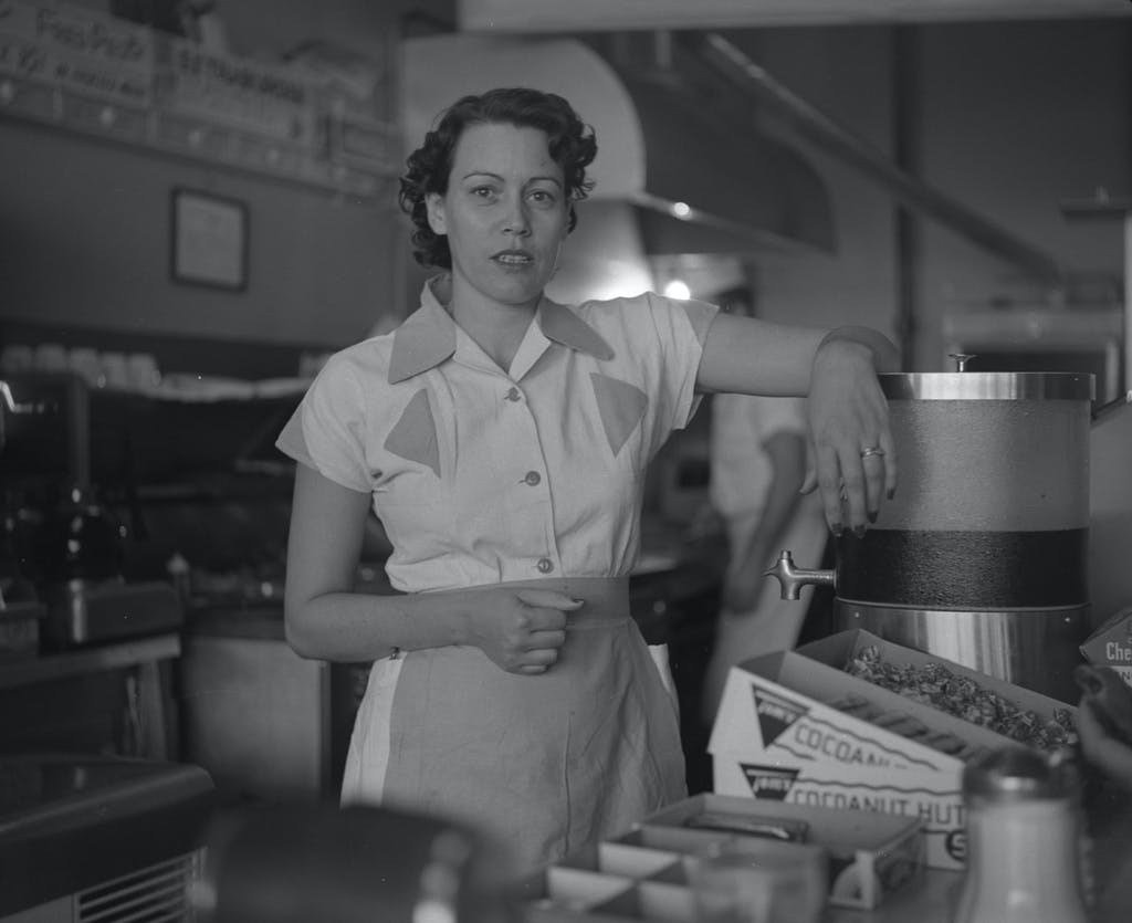 Waitress at Ernie's Hamburger Stand in Fort Worth. Taken by Byrd William III, 1955.