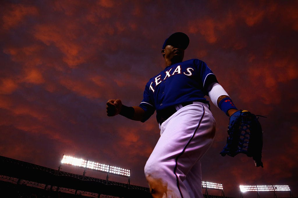 A Texas Rangers player returns to the dugout in the middle of the fourth inning as the Rangers take on the Colorado Rockies at Globe Life Park in Arlington on May 8, 2014 in Arlington, Texas.