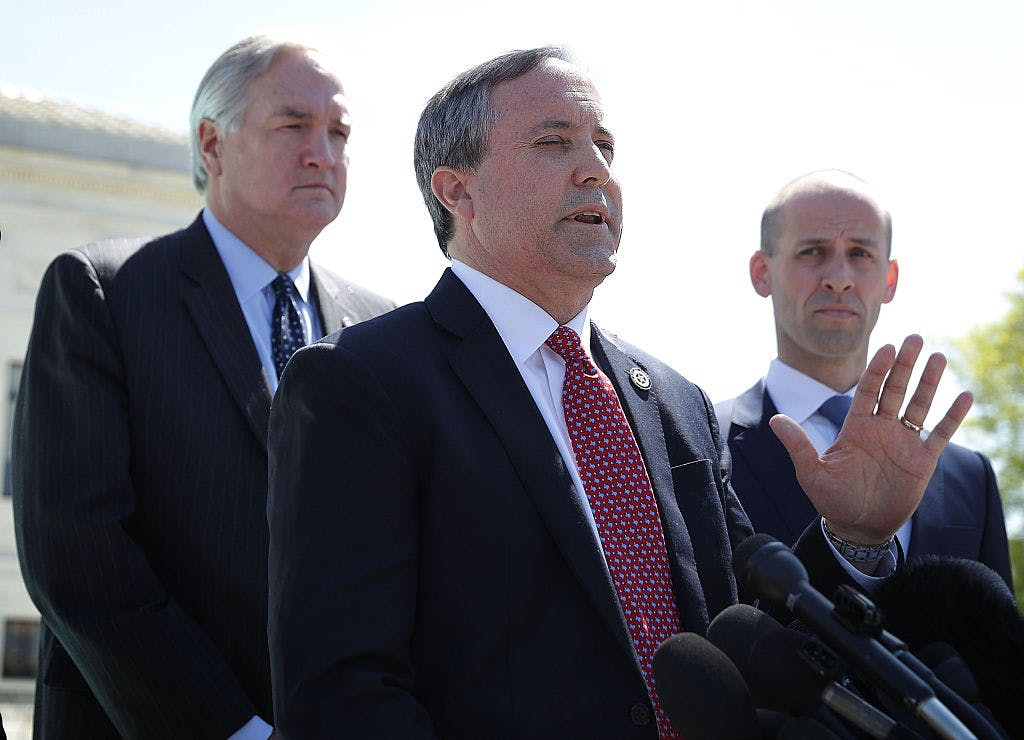 Texas Attorney General Kenneth Paxton (middle) speaks to members of the media in front of the U.S. Supreme Court April 18, 2016 in Washington, DC.