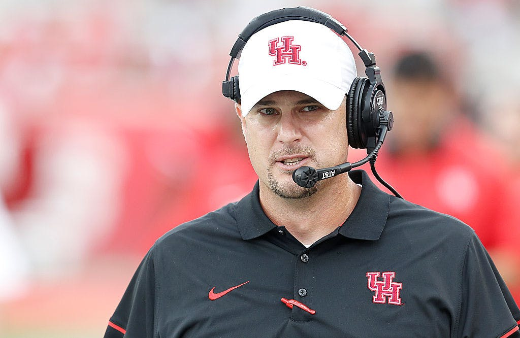 Former Houston Cougars head coach Tom Herman walks the sidelines as he coaches against the Lamar Cardinals in the second quarter at TDECU Stadium on September 10, 2016 in Houston, Texas. Houston won 42 to 0.