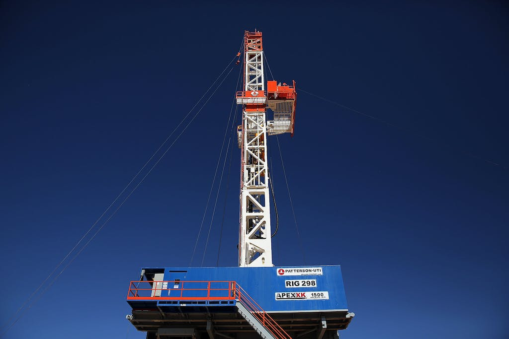 MENTONE, TX - FEBRUARY 05: The Patterson 298 natural gas fueled drilling rig drills on land in the Permian Basin that is owned by Apache Corporation on February 5, 2015 in Mentone, Texas.The rig, which is only 21 days old, is the first drilling rig in Texas that is 100-percent fueled by natural gas. As crude oil prices have fallen nearly 60 percent globally, many American communities that became dependent on oil revenue are preparing for hard times. Texas, which benefited from hydraulic fracturing and the shale drilling revolution, tripled its production of oil in the last five years. The Texan economy saw hundreds of billions of dollars come into the state before the global plunge in prices. Across the state drilling budgets are being slashed and companies are notifying workers of upcoming layoffs. According to federal labor statistics, around 300,000 people work in the Texas oil and gas industry, 50 percent more than four years ago. (Photo by Spencer Platt/Getty Images)