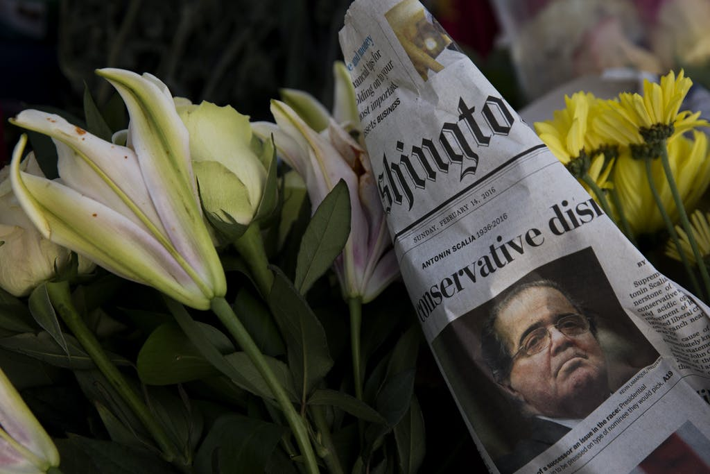 WASHINGTON, DC - FEBRUARY 14: A makeshift memorial for Supreme Court Justice Antonin Scalia is seen at the U.S. Supreme Court, February 14, 2016 in Washington, DC. Supreme Court Justice Antonin Scalia was at a Texas Ranch Saturday morning when he died at the age of 79. (Photo by Drew Angerer/Getty Images)