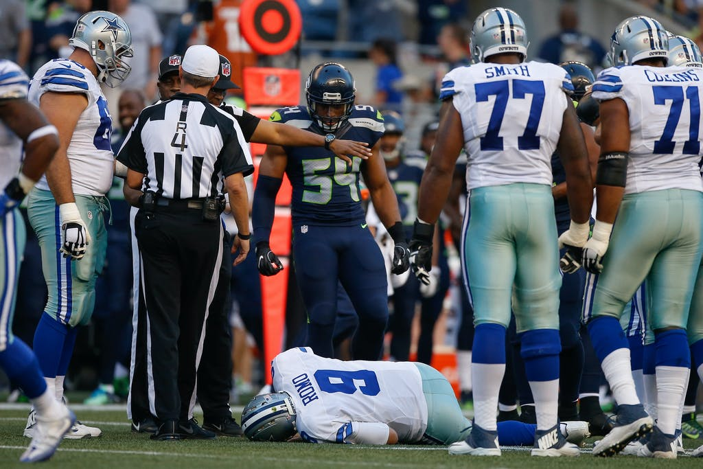 SEATTLE, WA - AUGUST 25: Quarterback Tony Romo #9 of the Dallas Cowboys lies on the turf after being injured in the first quarter during a preseason game against the Seattle Seahawks at CenturyLink Field on August 25, 2016 in Seattle, Washington. (Photo by Otto Greule Jr/Getty Images)