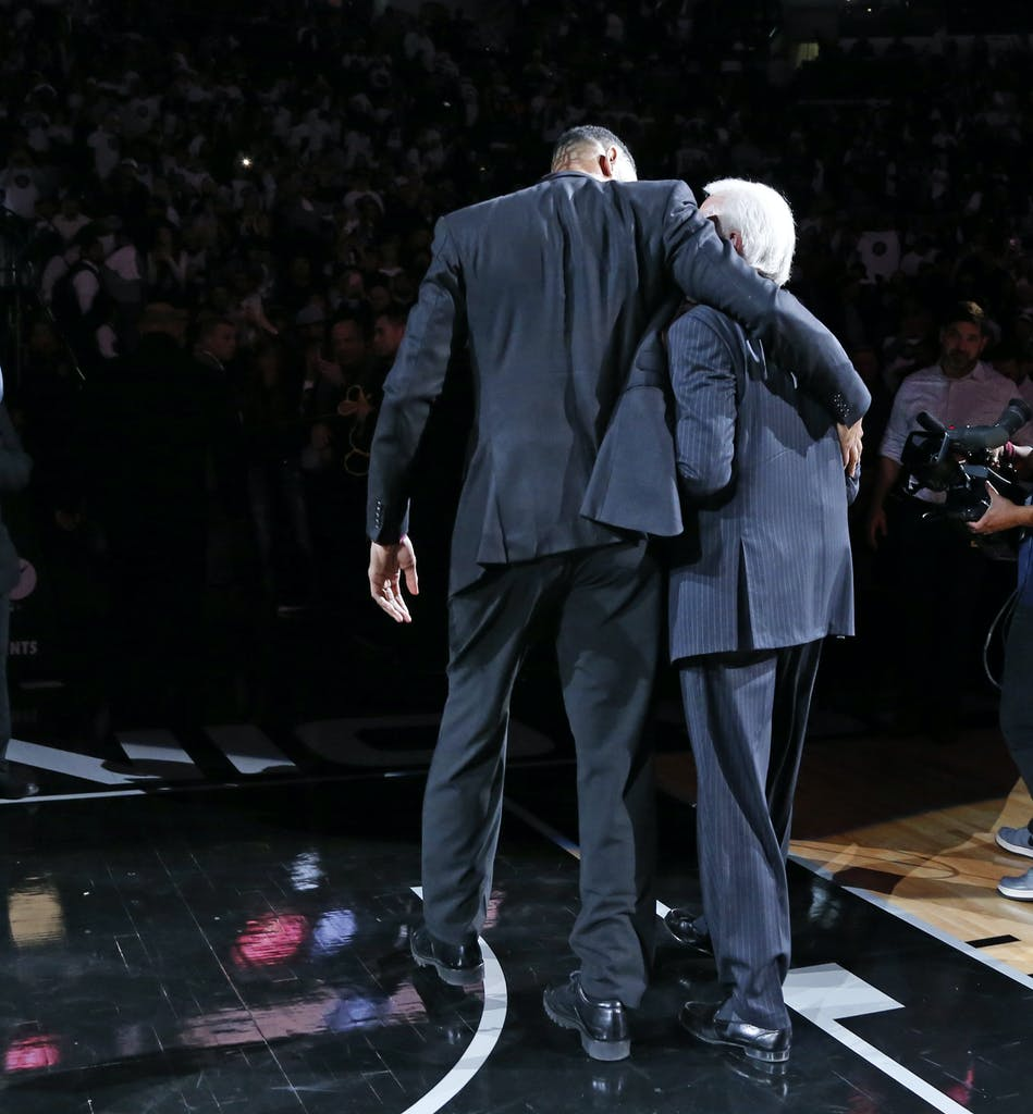 SAN ANTONIO,TX - DECEMBER 18: Tim Duncan hugs San Antonio head coach Gregg Popovic at the end of the ceremony as the two walk off the court when his number was retired after the game against the New Orleans Pelicans. Honoring and retiring of Tim Duncan number at AT&T Center on December 18, 2016 in San Antonio, Texas. NOTE TO USER: User expressly acknowledges and agrees that , by downloading and or using this photograph, User is consenting to the terms and conditions of the Getty Images License Agreement. (Photo by Ronald Cortes/Getty Images)