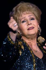 Debbie Reynolds performs February 7, 2002 at the Orleans Hotel & Casino in Las Vegas. Reynolds has been appearing in Las Vegas 40 years, first playing the Riviera in 1962.