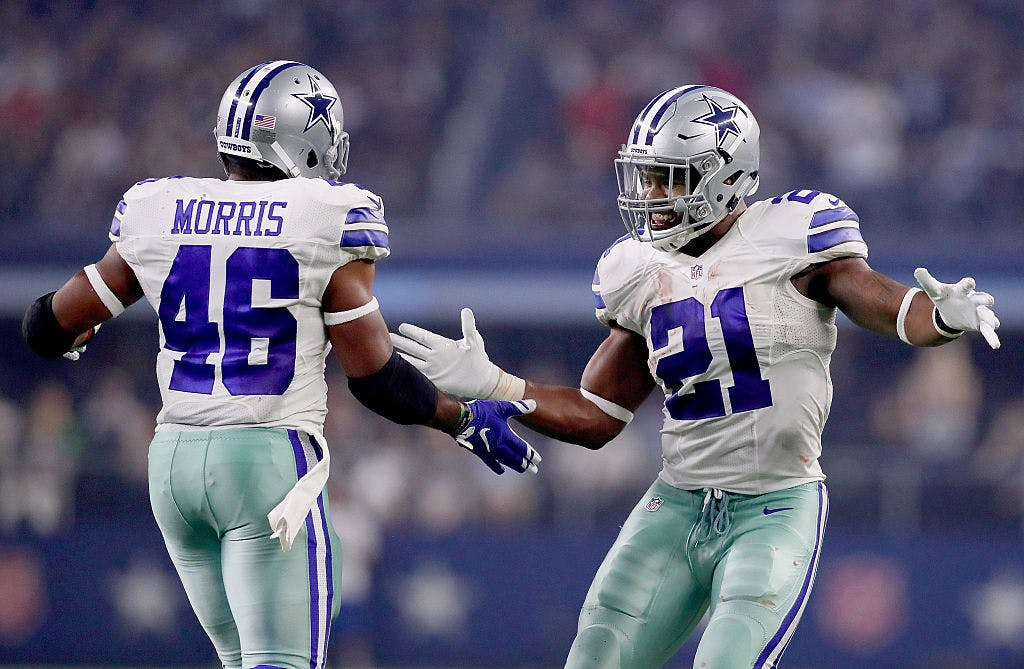 Ezekiel Elliott #21 of the Dallas Cowboys celebrates with Alfred Morris #46 of the Dallas Cowboys after Morris scored against the Chicago Bears in the second quarter at AT&;T Stadium on September 25, 2016 in Arlington, Texas.