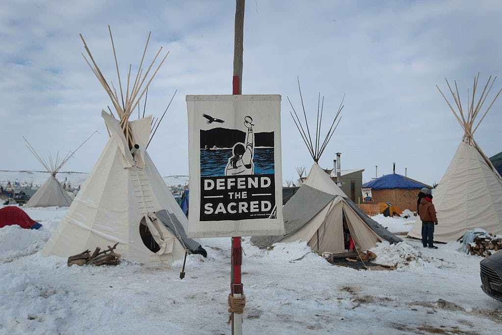 Snow covers the ground at Oceti Sakowin Camp on the edge of the Standing Rock Sioux Reservation on December 2, 2016 outside Cannon Ball, North Dakota. Native Americans and activists from around the country have been gathering at the camp for several months trying to halt the construction of the Dakota Access Pipeline.
