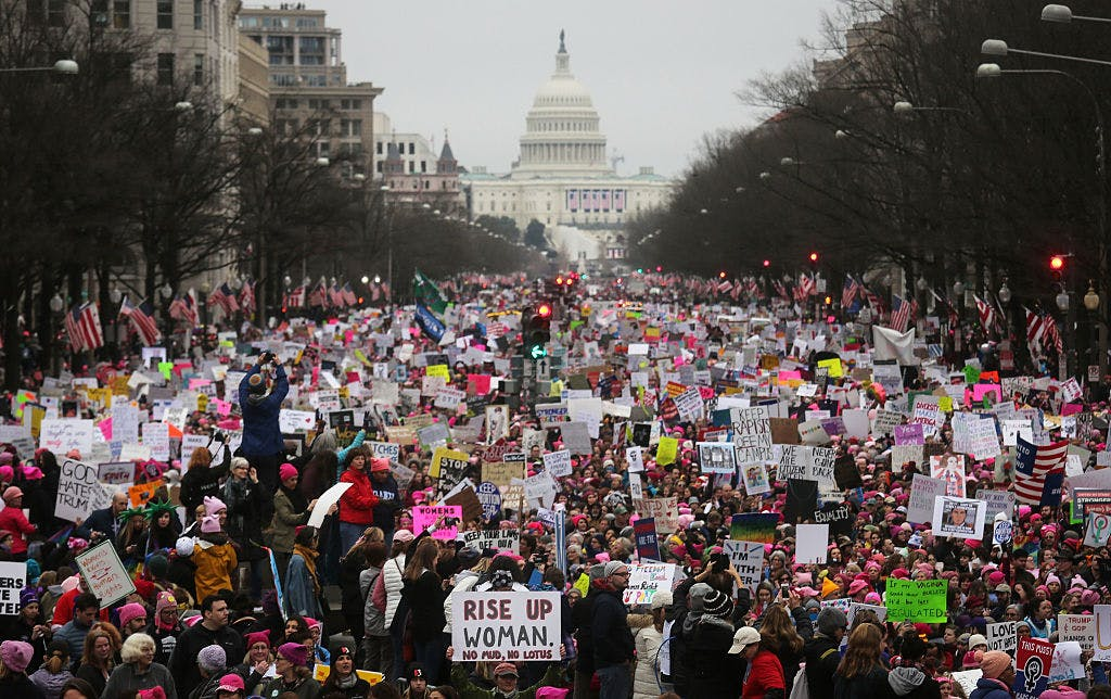WASHINGTON, DC - JANUARY 21: Protesters walk during the Women's March on Washington, with the U.S. Capitol in the background, on January 21, 2017 in Washington, DC. Large crowds are attending the anti-Trump rally a day after U.S. President Donald Trump was sworn in as the 45th U.S. president.