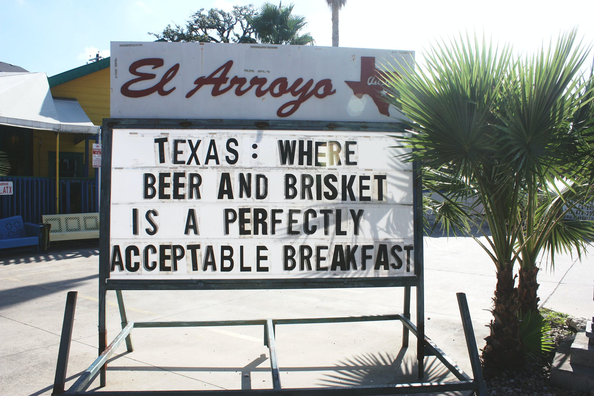 El Arroyo Sign says Texas: Where beer and brisket is a perfectly acceptable breakfast.