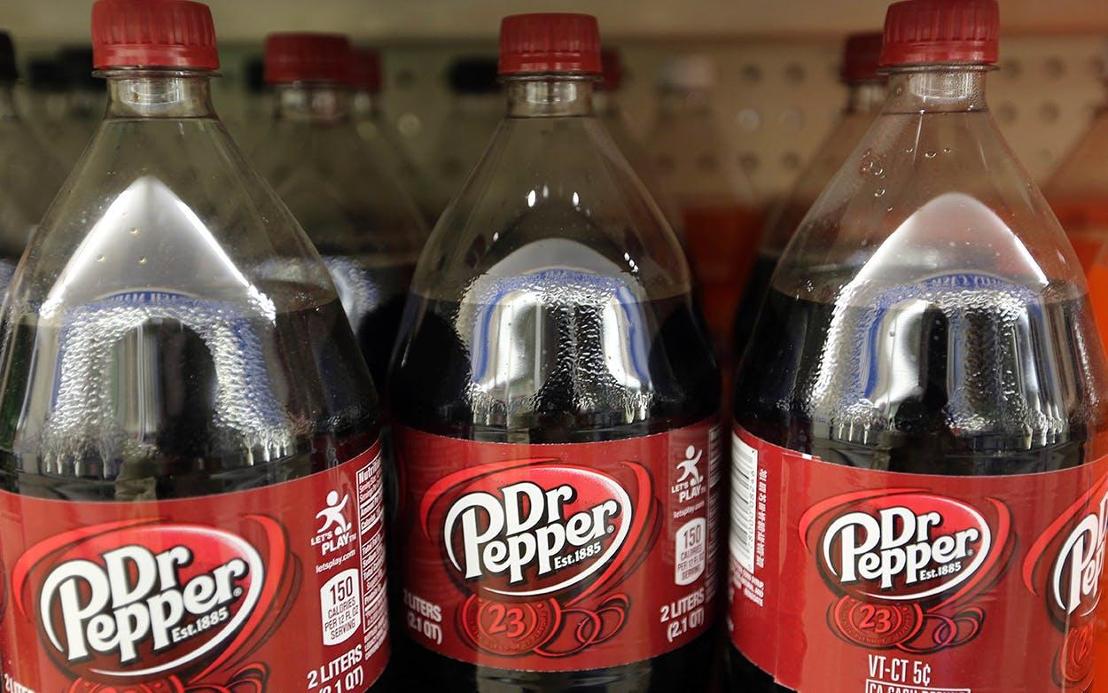 Dr. Pepper bottles on a shelf