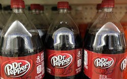 Dr. Pepper bottles on a shelf