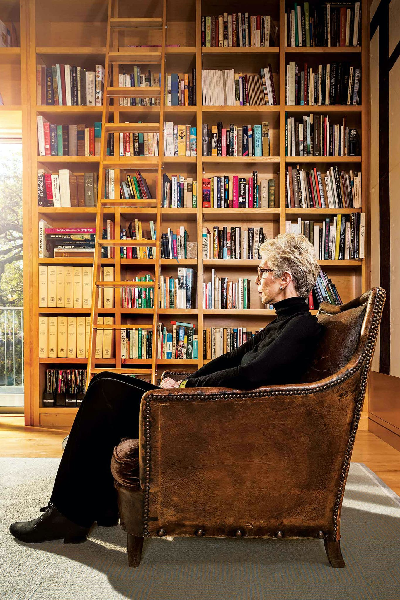 Melba Whatley in her home library in Austin
