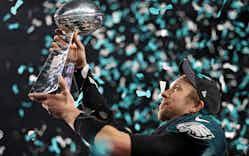 Quarterback Nick Foles #9 of the Philadelphia Eagles raises the Vince Lombardi Trophy