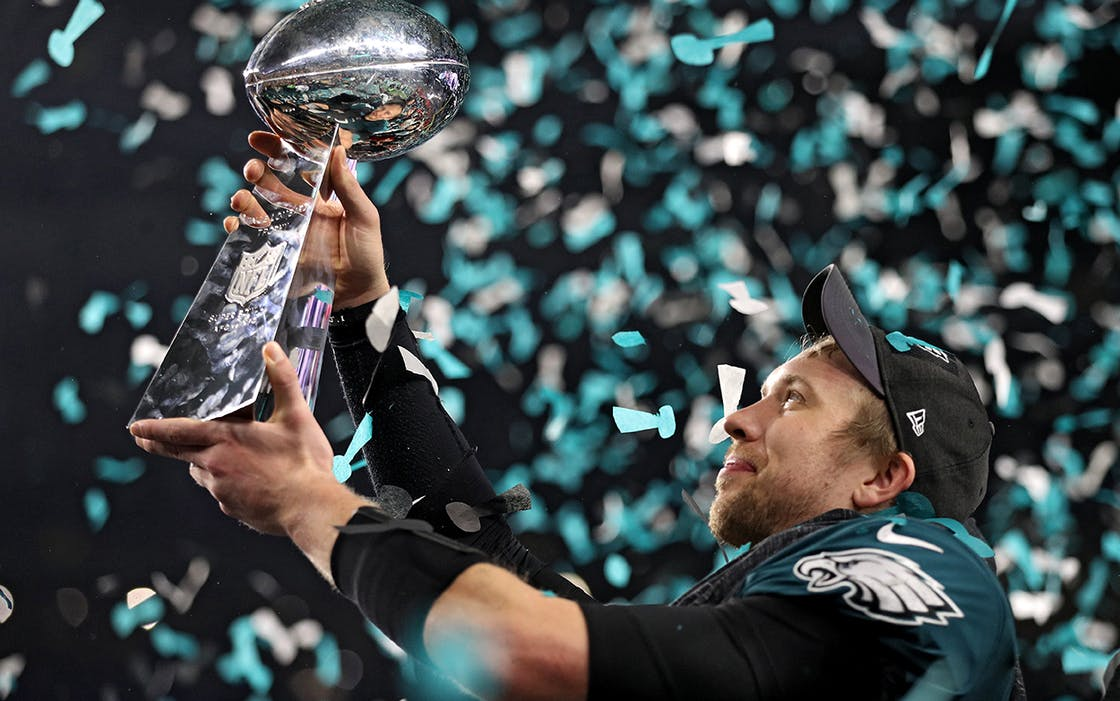 Quarterback Nick Foles #9 of the Philadelphia Eagles raises the Vince Lombardi Trophy