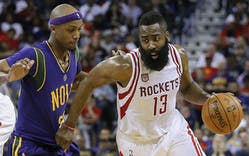 James Harden (#13) of the Houston Rockets drives against Dante Cunningham (#33) of the New Orleans Pelicans during the second half of a game on February 23, 2017 in New Orleans, Louisiana.