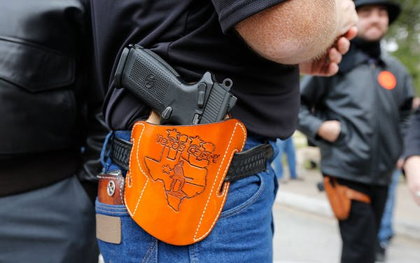 Man carrying pistol at open-carry rally