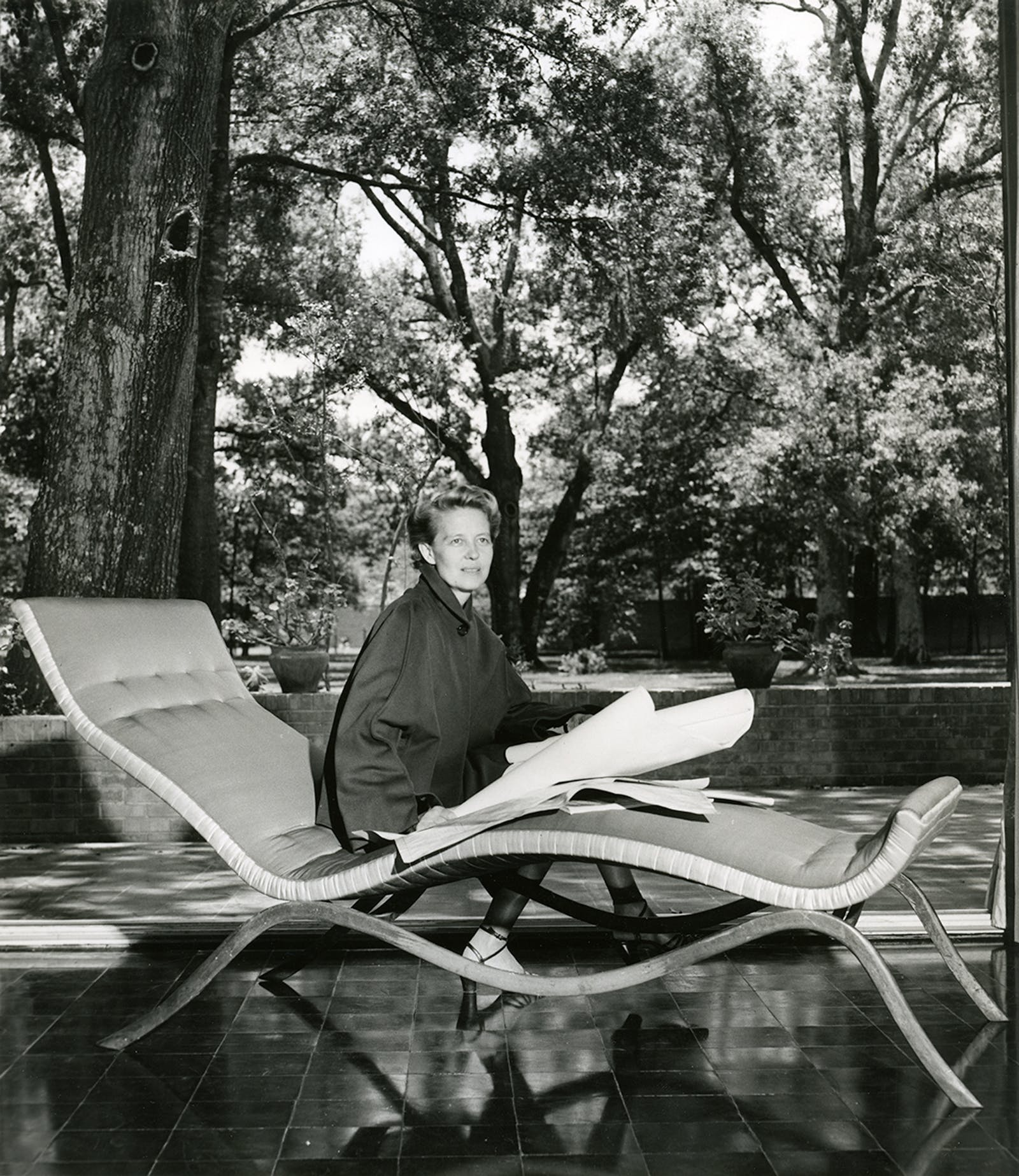 Dominique de Menil, in the early 1950s, wearing Charles James on a Charles James chaise lounge in the de Menil house in Houston.