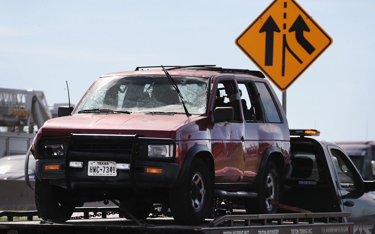 The vehicle that the Austin package bomber, Mark Anthony Conditt, was driving when he blew himself up is towed from the crime scene along Interstate 35 on March 21, 2018 in Round Rock.