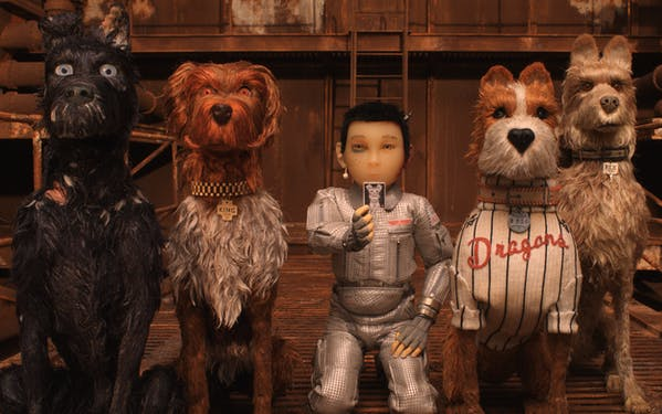 """Atari, a character voiced by Koyu Rankin, is flanked by canine characters Chief (Bryan Cranston) and King (Bob Balaban) on the left and Boss (Bill Murray) and Rex (Edward Norton) on the right in Wes Anderson's """"Isle of Dogs."""""""
