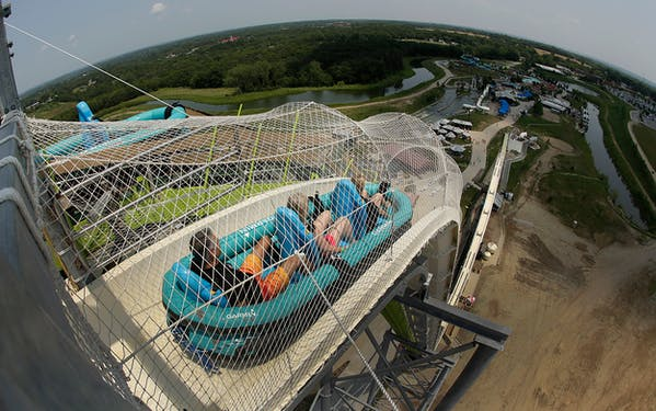 Riders go down the world's tallest water slide called