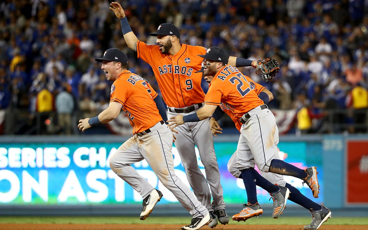 Alex Bregman #2, Marwin Gonzalez #9, Carlos Correa #1, and Jose Altuve #27 of the Houston Astros celebrate defeating the Los Angeles Dodgers 5-1 in game seven to win the 2017 World Series at Dodger Stadium on November 1, 2017 in Los Angeles, California.