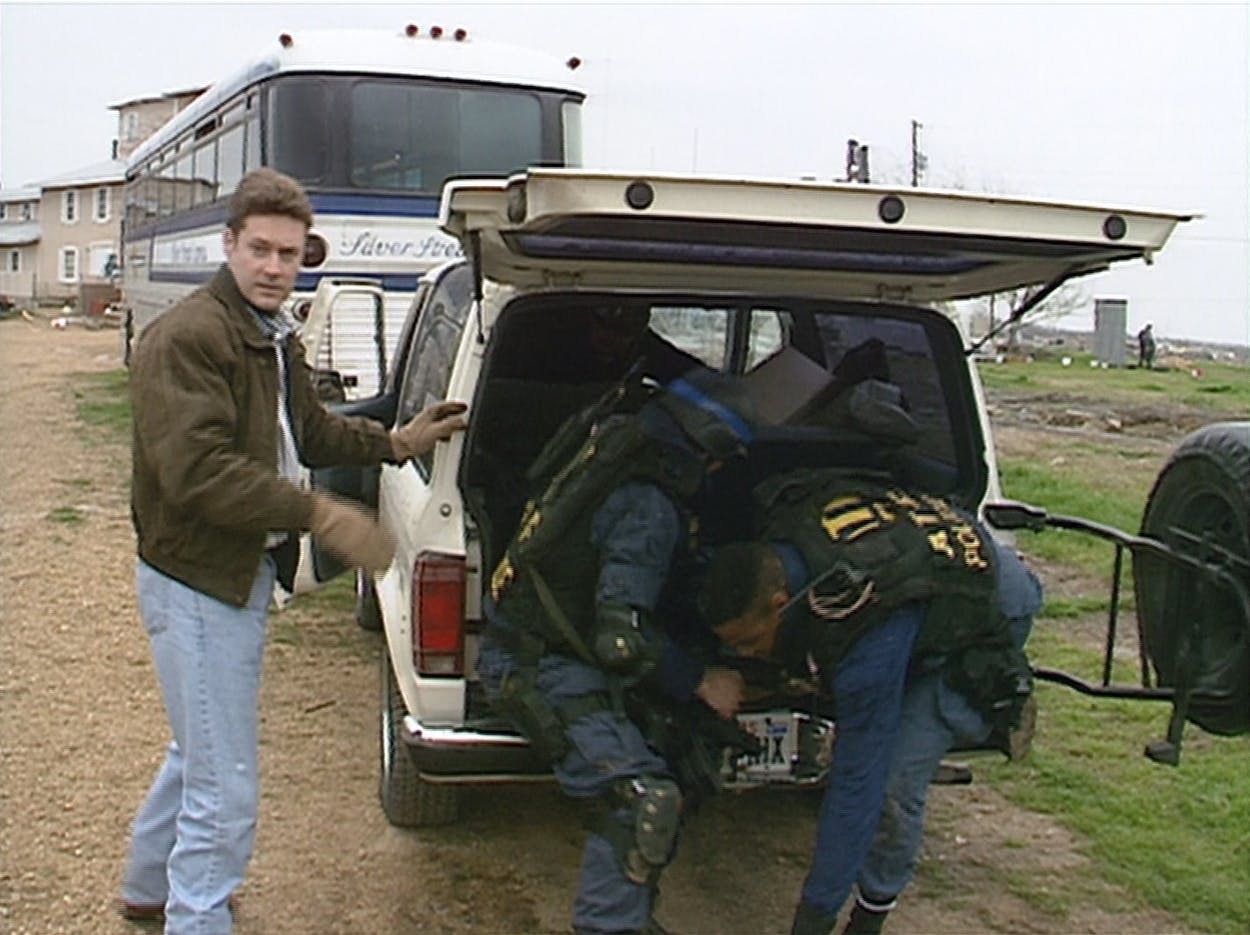 KWTX reporter John McLemore (far left) arrived at Mount Carmel on February 28, 1993, expecting to cover a routine seizure of illegal weapons.