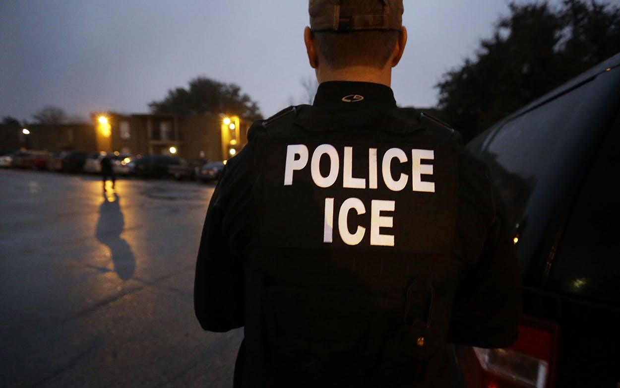 U.S. Immigration and Customs Enforcement agents search for a specific undocumented immigrant during an operation in Dallas on March 6, 2015.