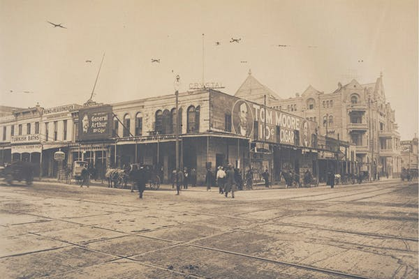 Historical photo of the intersection of Congress Avenue and Pecan Street in Austin, Texas.