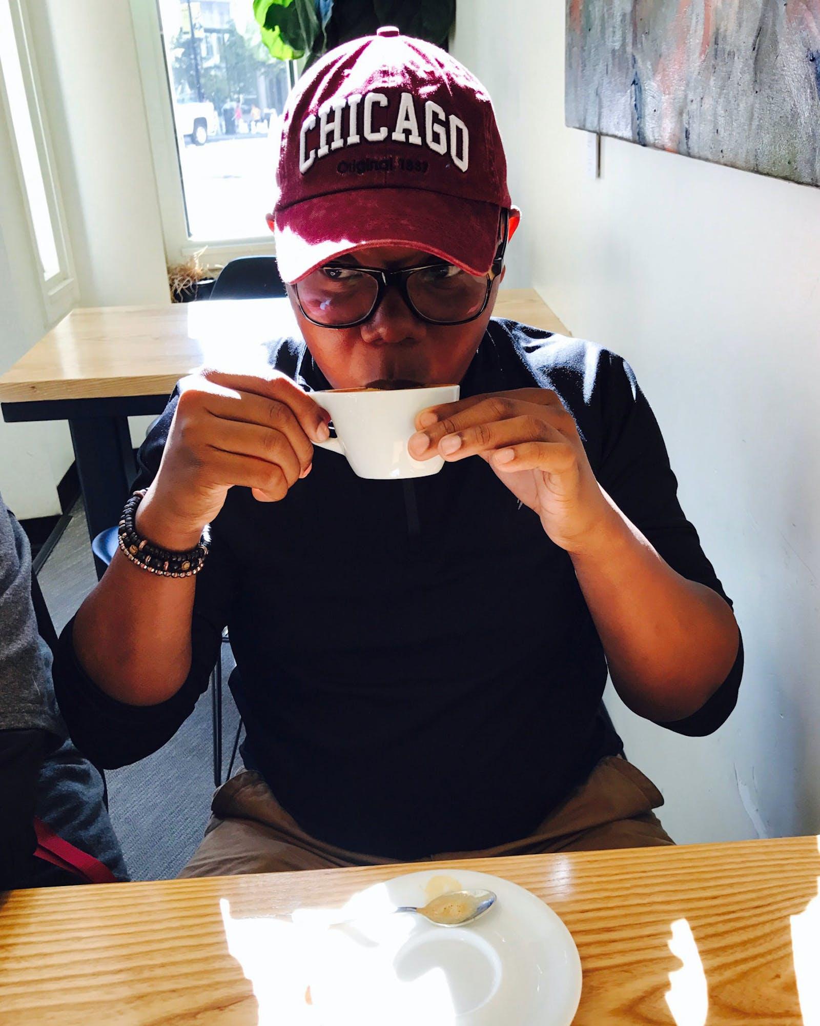 Draylen Mason drinking coffee.